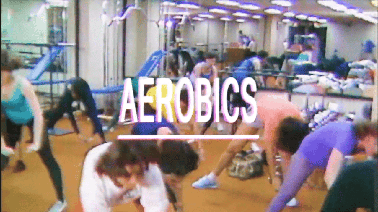 "photo of 1980s aerobics studio with the word ""aerobics"" written across is"