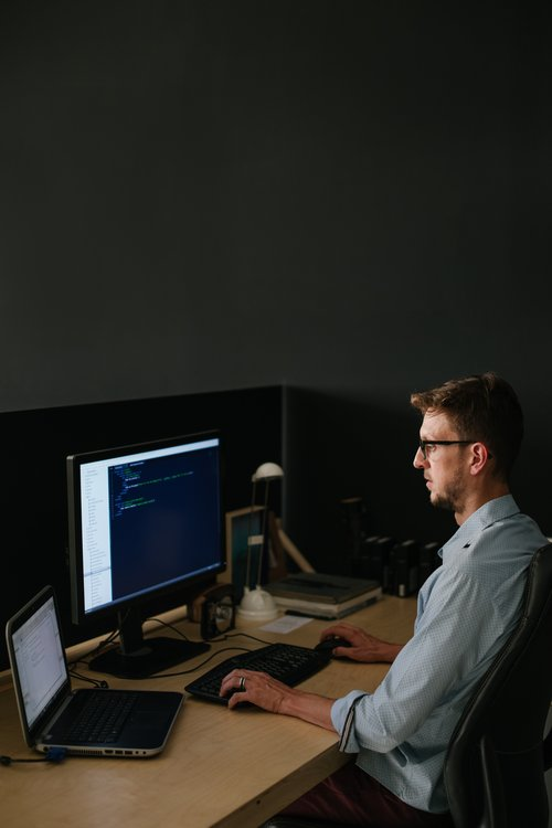 A website/software developer busy coding in his studio
