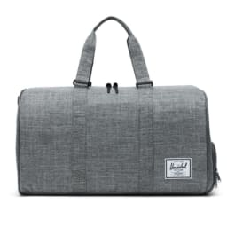 Grey Herschel duffle bag with a hand strap for carrying